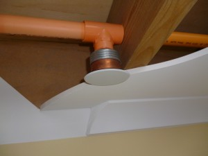 A cut-away view of a modern concealed firesprinkler head in place